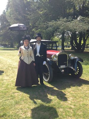 After a long hot day John and Aylwen finally get their picture taken in front of a lone vintage car.